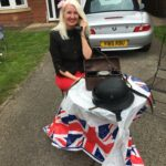 A lady using field phone on Ve Day at home