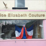 Shop front with red white and blue wedding dress