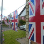 a lot of union flag bunting in street