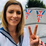 A sailor lady giving v for Victory sign