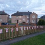 A fantastic string of bunting on fence