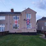 Soeveralf flags on house on estate