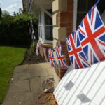 Flags flying on a house i the wind