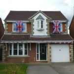 detached House with flags on estate