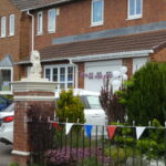 Sone VE day bunting on a house in Featherstone Estate