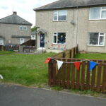 Coloured bunting in streetscene