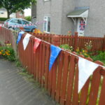 Coloured bunting on fence