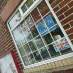 Village Hall window with flags