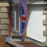 A flag flying from window