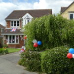 f flag and bunting on house with balloons