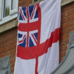 Ensign flag hanging from window