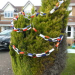 Coloured bunting around tree