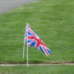Two union flags on lawn