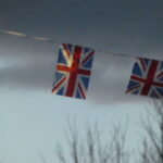 Two union flags at dusk